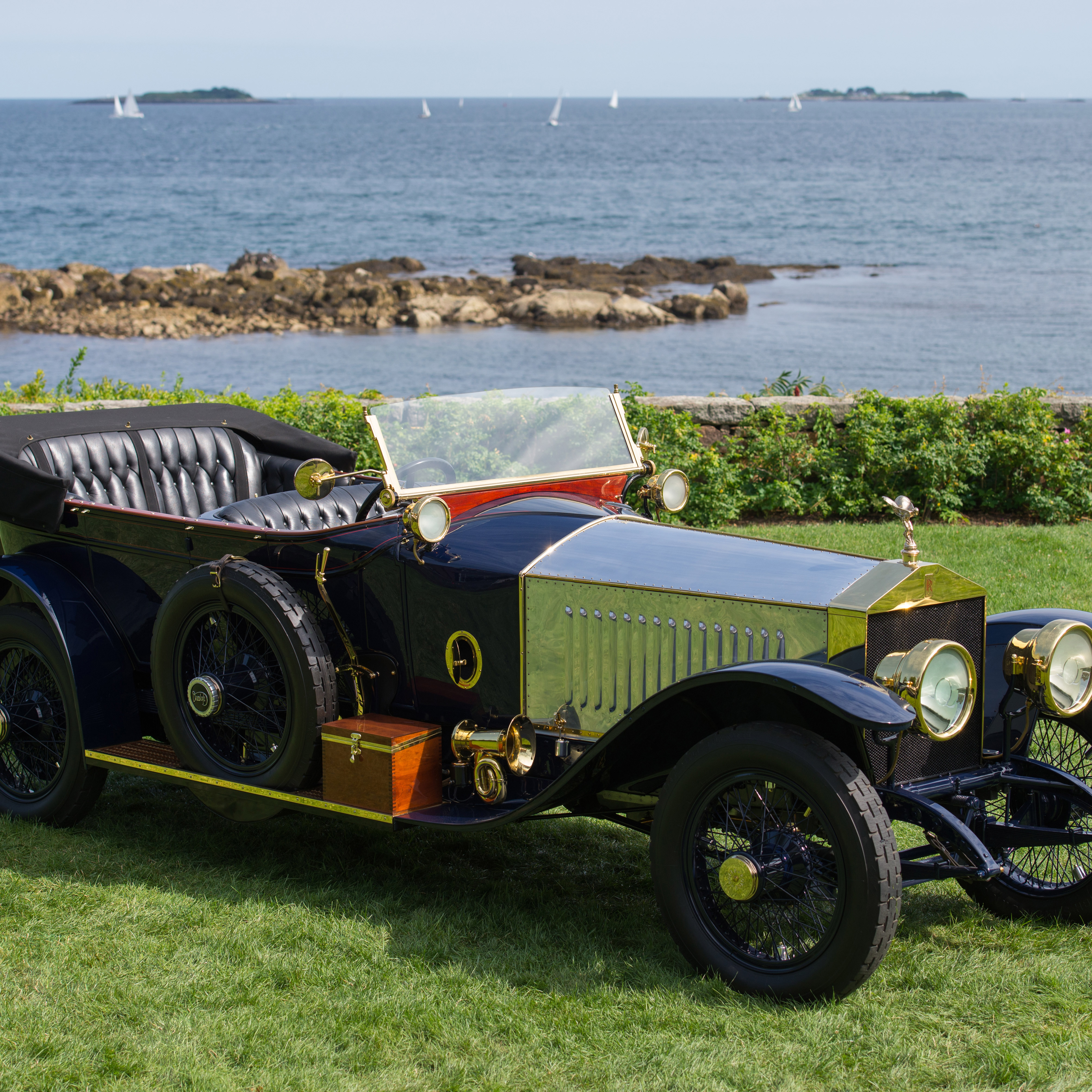 car parked on slight hill with ocean in background at misselwood for concours d'elegance