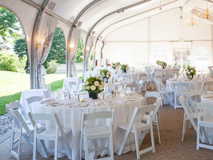 Formal wedding reception under outdoor tent