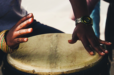 Close up image of someone playing a drum