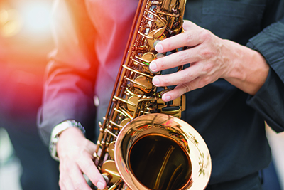 Close up image of someone playing the saxophone