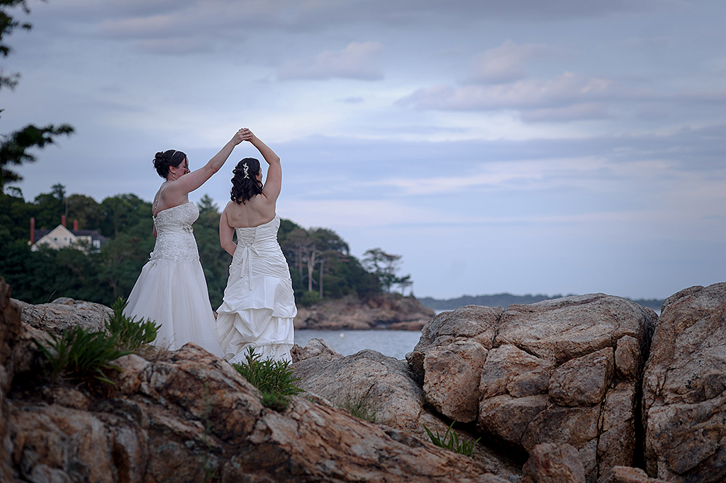 Wedding couple dancing on Misselwood rocks on the ocean