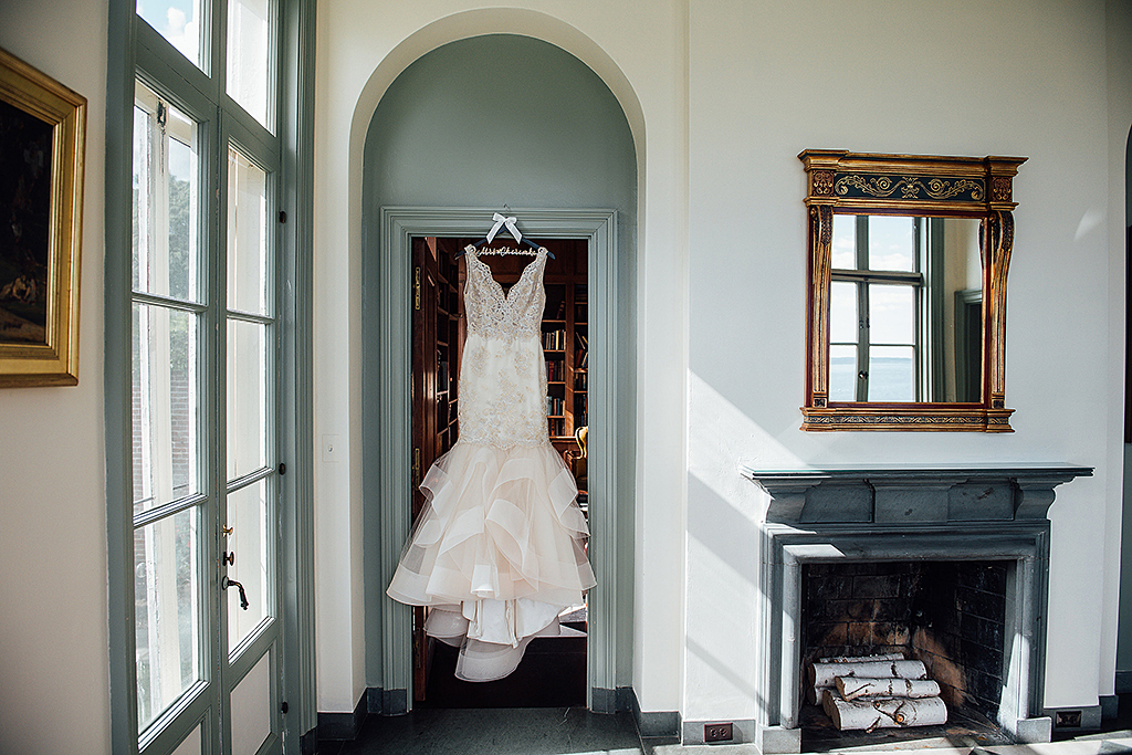 Bridal gown hanging in Misselwood house Ocean Room doorway